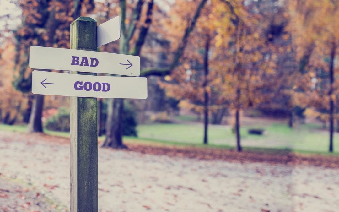 photo of directional signs that say bad and good